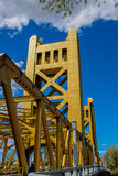 Sacramento golden tower bridge. Surrounded by cobalt blue skies the Sacramento golden bridge stands tall as a symbol, of our state capital Stock Photo