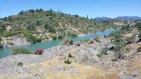 Sacramento River in Redding California. View of the beautiful Sacramento River from the adjacent walk and bike trail. Peaceful setting surrounded by nature Stock Photography