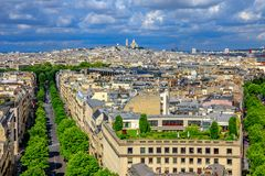 Sacre-Coeur aerial panorama. Paris skyline aerial view panorama from top of Arc de Triomphe. Distant Sacre-Coeur church of Paris or Sacred Heart Basilica Stock Photography