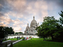 Sacre Coeur as seen from below with dramatic evening clouds in background Stock Photo