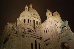 The Sacre Coeur Basilica at night, Paris. The Roman Catholic Basilica in Paris, France. It is a popluar landmark in Paris. It gives a nice landscape of the whole stock photo