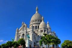 The Sacre Coeur Basilica on Paris Butte Montmartre. The Sacre Coeur Basilica of the Sacred Heart of Paris tourist landmark Roman Catholic church at the summit of Stock Photos