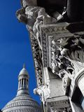 Sacre Coeur Basilica Paris #35. Detail of stone pediment carved an arch (back of the basilica). The top of a dome and its lantern is visible in the background Royalty Free Stock Photo