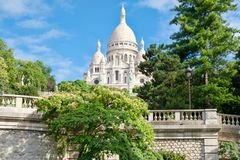 The Sacre Coeur Basilica in Paris. At the summit of the hill of Montmartre stock images