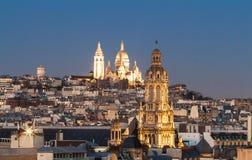The Sacre Coeur basilica and Saint Trinity church at night, Paris, France. royalty free stock photo