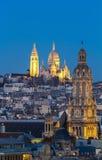 The Sacre Coeur basilica and Saint Trinity church at night, Pari Royalty Free Stock Images