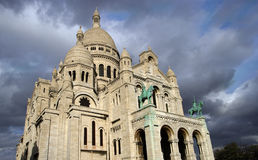 Sacre Coeur church basilica. Exterior of Sacre Coeur church basilica with dark cloudscape background, Paris, France Royalty Free Stock Images