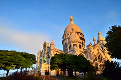 Sacre Coeur at dawn. The Basilica of the Sacred Heart of Paris, commonly known as Sacré-Cœur Basilica and often simply Sacré-Cœur  is a Roman Catholic church Stock Photography