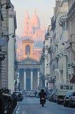 Sacre Coeur from Downtown Paris. Sacre Coeur (Sacred Heart) Cathedral viewed from downtown Paris street Stock Images