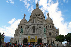 Sacre-Coeur in Montmartre, Paris. People in front of the famous basilica of Sacre-Coeur in Montmartre, Paris Royalty Free Stock Photo