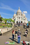 Sacre Coeur in Paris, France. Street sellers in front of the church of Sacre Coeur (blessed heart) in the neighbourhood of Montmartre in Paris, France royalty free stock photography
