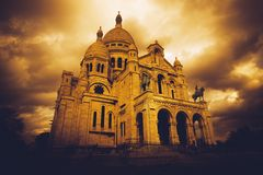 Sacre Coeur in Paris. France, as storm clouds gather. Heavily filtered image for mood and atmosphere stock images