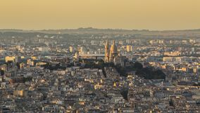Sacre coeur in Paris at golden hour. Panorama of old city with great population and density in sunset light stock photography
