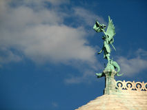 Sacre Coeur statue. Angel Statue on the roof of the Sacre Coeur basilica in Montmartre, Paris Royalty Free Stock Image