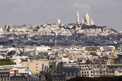 Sacre Coeur towering over paris. Sacre Coeur Chruch situated in a commanding position over Paris.  Taken from the Eiffel Tower Royalty Free Stock Image