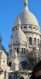 Sacre Coeur. Vertical shot of Sacre Coeur in Paris from a street in Montmartre Royalty Free Stock Photos