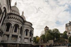 Sacre Couer Basilica and the Paroisse Saint-Pierre de Montmartre church in Paris, France, with surrounding streets Stock Photography