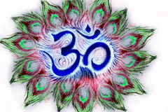 Sacred aum sanskrit symbol in circle of peacock feathers Stock Image
