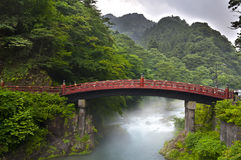 Sacred bridge Shinkyo. Red sacred bridge Shinkyo in Nikko, Japan and a mist rising from the river Stock Photo