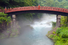 Sacred bridge Shinkyo. Red sacred bridge Shinkyo in Nikko, Japan and a mist rising from the river Royalty Free Stock Image
