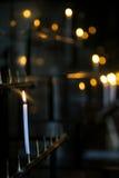 Sacred burning candles the shrine Royalty Free Stock Image