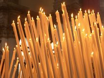 Sacred candles. Burning candles in cathedral in Venice Stock Photo