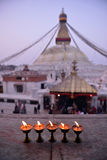 Sacred candles in front of Boudha Nath (Bodhnath) stupa Stock Photos