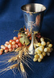 Sacred Chalice. A sacred chalice is adorned by grapes and wheat stock photos