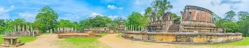 In sacred city of Polonnaruwa. Panorama of Dalada Maluwa site of the sacred city of Polonnaruwa with the preserved Buddhist shrines and historic buildings, Sri royalty free stock image