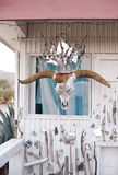 Sacred Art Home. An eccentric southwestern artist's studio dwelling with a unique artful mirror crowned cow skull stock photography