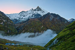 The Sacred Fishtail Mountian seen in the distance, sunrise, in Annapurna Range, Nepal. The Sacred Fishtail Mountian (Machhapuchre) seen in the distance, sunrise stock photos