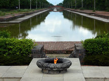 Sacred Flame at the Central Canal of Lumbini Royalty Free Stock Photo