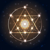 Sacred Geometry. Abstract geometric shapes on a dark blue glowing background Royalty Free Stock Photo