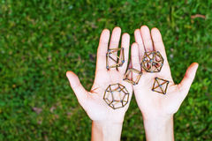 Sacred geometry. Female hands holding sacred geometry royalty free stock image