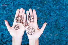 Sacred geometry. Female hands holding sacred geometry stock image