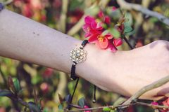 Sacred geometry metal natural stone bracelet. On female wrist stock images