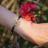 Sacred geometry metal natural stone bracelet. On female wrist stock photos