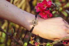 Sacred geometry metal natural stone bracelet. On female wrist royalty free stock images