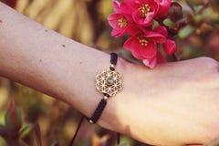 Sacred geometry metal natural stone bracelet. On female wrist royalty free stock photos
