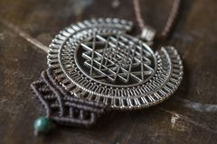 Sacred geometry metal pendant necklace. With chrysokol stone bead stock image