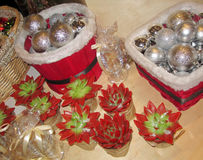Sacred geometry pattern. Sacred geometry. Red and green flowers and silvery christmas balls are in pots and baskets. Basket with flowers. Christmas background Stock Photos