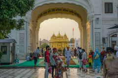 Amritsar, India - July 8, 2017: The sacred Golden Temple in the middle of the sacred lake. Every day tens of thousands of people a royalty free stock photos