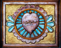 Sacred Heart Carved on Wood. An image of the Sacred Heart of Jesus hand-carved and painted on wood royalty free stock photos