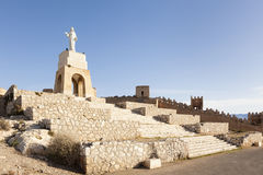 Sacred heart of Jesus monument and ruins of Alcazaba wall, Almeria, Spain stock images