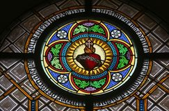 Sacred Heart of Jesus. Stained glass window in the parish church of St. Peter and Paul in Oberstaufen, Germany stock images