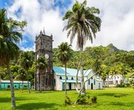 Sacred Heart Roman Catholic Church with a Clock tower. Colourful vibrant old colonial capital of Fiji: Levuka town, Ovalau island. stock photo