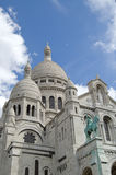 Sacred Heart (Sacre Coeur) Cathedral. Upwards view of the famous landmark, Sacred Heart (Sacre Coeur) cathedral in Paris, France, against cloudy blue skies royalty free stock photography
