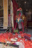 Sacred Horse of Chinese Hungry Ghost Yu Lan festival was surrounded by believers` offerings. Royalty Free Stock Photography
