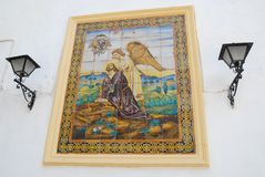 Sacred image on white wall in Jerez de la Frontera in Spain Stock Image