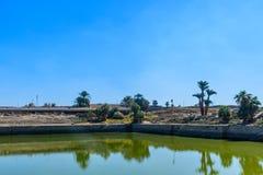 Sacred lake in Karnak temple. Luxor, Egypt. Sacred lake in ancient Karnak temple. Luxor, Egypt stock photo